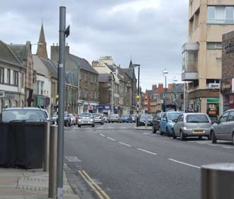 Image looking east along dalkeith high street, disabled parking, one on imediated left and two the far side of the Zebra Crossing
