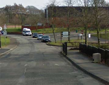 Entrance to Beeslack High School disabled parking on right