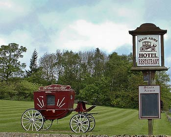 Image of the old coach outside the Stair Arms Hotel